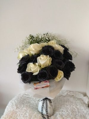 Bouquet of white and black roses