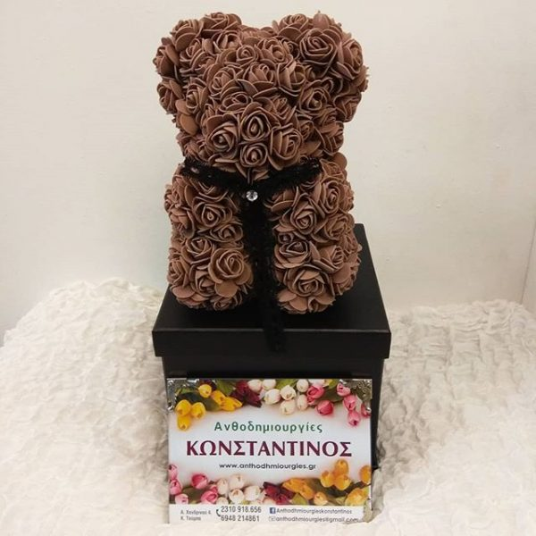 teddy bear with brown roses