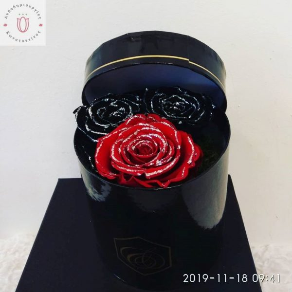 Composition with 2 wonderful forever black and red roses with silver glitter.