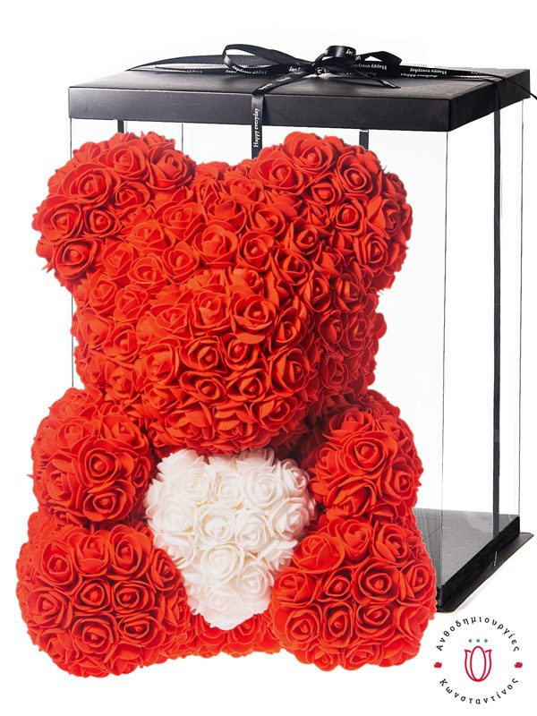 Teddy bear with red roses and white heart in a luxury gift box. The best Valentine's Day gift