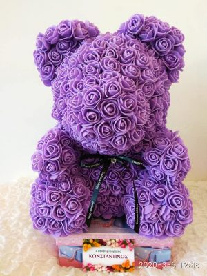 teddy bear with purple roses